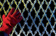 Welded razor wire mesh giveWelded ras a high-security protective fence